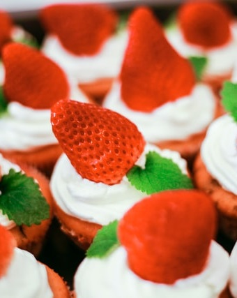 strawberries and cream on cupcakes in June
